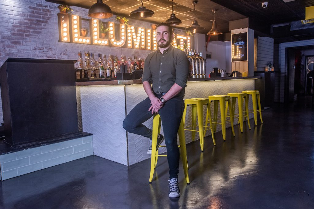 James Gibb in Illuminati in front of the bar