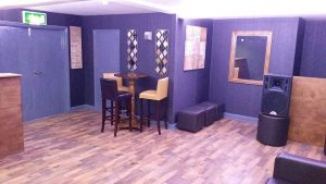 Stylish Office Bar with high table and bar to the left