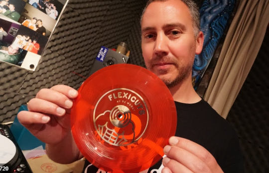 DJ woody holding up a record
