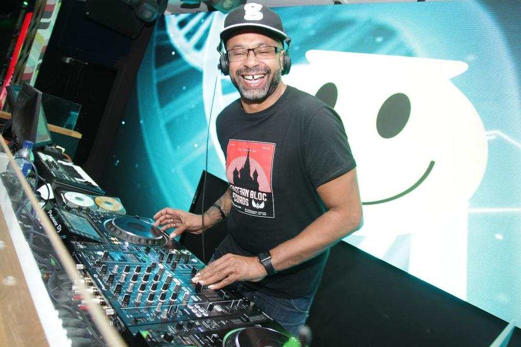 Mark XTC smiling camera whilst DJing