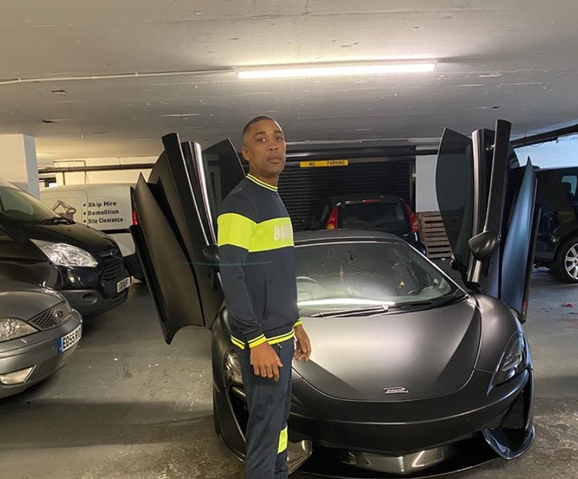 Wiley standing in front of supercar
